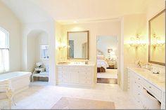 marble floors, venetian sconces, looks like the MTI tub I want also...