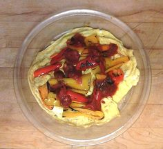 Great breakfast today!!!! 2 egg yolks, 4 egg whites, pepper and onion powder omelet topped with pre-grilled red, orange and yellow baby peppers and sugar-free salsa!