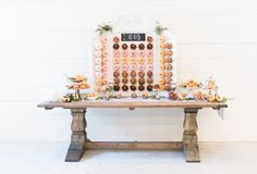 donut table - photo by Olivia Morgan Photography http://ruffledblog.com/get-inspired-by-this-beautiful-wedding-cake-table