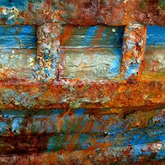 i like this rusty boat art as its decay has created rough textures with the colours shedding light on the piece