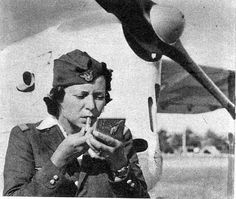 A Romanian Air Force pilot adjust her makeup before a mission in WWII, 1943