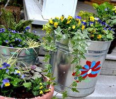 Pretty up the porch for autumn with tubs of cheerful pansies. Blogger Lucy Mercer (@acookandherbook) lets her daughters embellish them with paint.