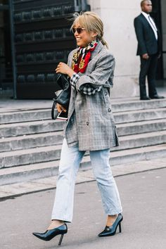 Find out how fashion girls are styling their favorite plaid pieces for 2018. We have the street style shots to prove the trend isn't going anywhere.