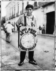 Young boy with clock advertising sandwich board Photography Tags, Sandwich Board, Slums, Polaroids, Public Transport, Merida, National Parks, Advertising, Clock