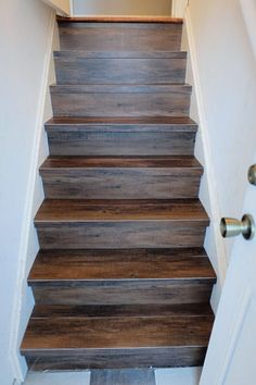 A DIY install of peel and stick wood-look vinyl flooring on our back stair.