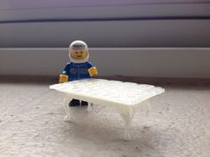 3d Printed Coffee Table.  First test print on new MakerBot Replicator 5th Generation.  Yes, Lego man likes it.