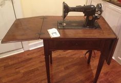 1929 Singer Sewing Machine and Table- $400  http://www.etsy.com/shop/SouthernRestoration1?ref=search_shop_redirect