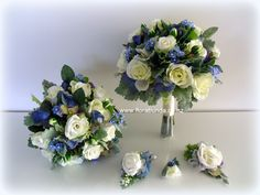 Silk flowers with buttonhole and corsages to match. Adding soft silver and greys gives blue the perfect compliment Home Decor Floral Arrangements, Corsages, Artificial Flowers, Silk Flowers, Shades Of Blue, Wedding Flowers, Floral Wreath, Wreaths, Stylish
