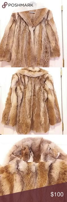 Very warm fur coat I am unsure of the manufacturer or the type of fur but this coat is very warm and beautiful. The lining shows wear but could be replaced. Jackets & Coats
