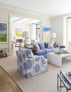 Bright and airy living room with blue, white and neutral hues.