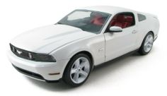 1:18 2010 Ford Mustang GT Performance White by Greenlight. $34.95. From the Manufacturer                Details include:  Die-cast metal body, opening doors, hood and trunk, working hood prop, detailed engine with spark plug wires, authentic factory paint job, detailed lights, carpeted interior and fabric seatbelts, sequentially numbered, and officially licensed by Ford.                                    Product Description                This is a brand new GreenLight ...