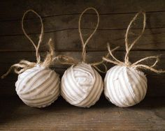 beautiful neutral taupe and cream cotton ticking fabric to make these ragballs built on hollow mache ball cores. The stripes, raw edges, and jute twine blend together just perfectly.
