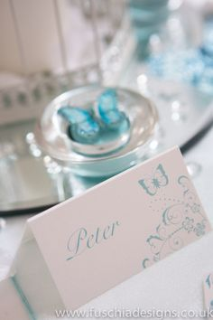 Spearmint butterfly wedding stationery. Printed and personalised place name. www.fuschiadesigns.co.uk
