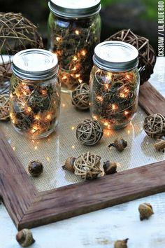 Use dried moss, acorns, and string lights to craft these rustic lanterns, perfect for cool evenings spent outside.