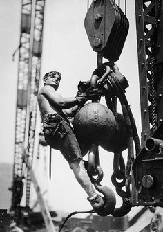 A construction worker on the Empire State Building. 1931 Photo by Lewis Wickes…