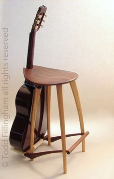 Guitar Stool/ Guitar Stand by fillingham on Etsy. Nice, but out of my price range. Maybe I can build one.