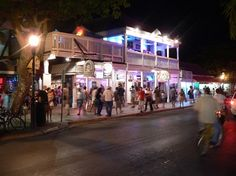 Duval Street. Key West, Florida.  Super fun place to shop and listen to music!!  Go to www.YourTravelVideos.com or just click on photo for home videos and much more on sites like this.