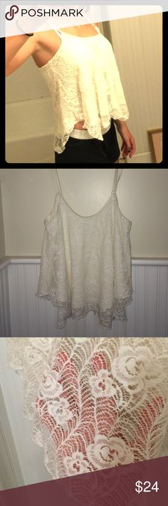 Flower lace flowy white tank top Flowy white tank top with adjustable straps and beautiful flower lace designs on top of comfy fabric. Tops Tank Tops