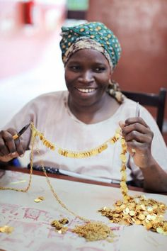 An artsian hand crafts jewellery for People Tree at Bombolulu, a Fair Trade organization in Kenya #fashiontakesaction