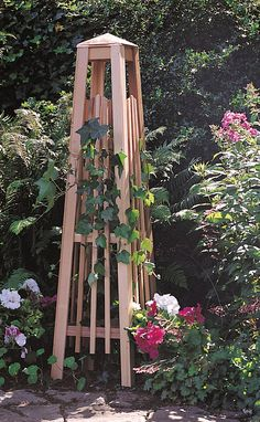 Sy And Substantial Wood Garden Obelisk Provides A Place For Vines To Climb