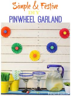 How to make this easy festive simple pinwheel garland - the perfect thing for adding to any party décor, whether it be Cinco de Mayo décor, birthday party décor, or even baby shower décor.
