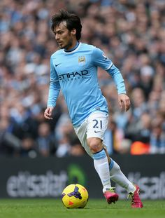 David Silva Photos - David Silva of Manchester City in action during the Barclays Premier League match between Manchester City and Arsenal at Etihad Stadium on December 2013 in Manchester, England. - Manchester City v Arsenal - Premier League Arsenal Premier League, Premier League Matches, Burnley Fc, Zen, Football Stadiums, Manchester City, David, Running, Fitness