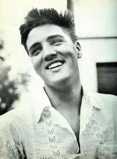 Wednesday, August 19, 1959: Elvis wearing a shirt with eyelet embroidery gives an interview to BRAVO correspondent G. Thomas Beyl in his rented house at Goethestraße 14 in Bad Nauheim, Germany. Here he is pictured in front of his home. Interesting sidenote: BRAVO is still the biggest German teenager magazine to this day (first issued on August 26, 1956). Also see the following photo: https://www.pinterest.de/pin/380906080973411415/