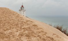 Burried Lighthouse by David Fischer on 500px