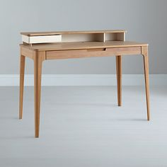 John Lewis, Mira Desk. Nice refined form, detachable top storage section. Annoying full length draw though.