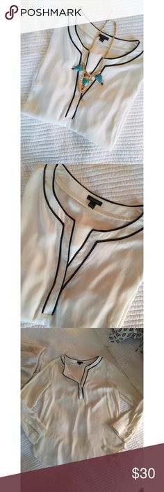 • Ann Taylor • Creme • Black lining around the neck • Loose fit • Excellent condition • 100% Polyester • NO TRADES/HOLDS • All reasonable offers accepted • Ann Taylor Tops