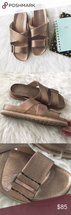✨flash sale✨nwt//calvin klein dusty bronze slides ▫️calvin klein - sold out online! ▫️the Valeri slides in dusty bronze  ▫️leather upper with cross-cross straps  ▫️easy slip-on style with open toe ▫️man made lining and footbed ▫️size: 7.5 Medium ▫️condition: new with box  •please see all pics, read description, and ask questions before purchasing  •no trades• Calvin Klein Jeans Shoes Sandals
