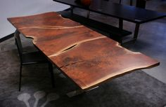 Top Concept:urban hardwoods table-we like the alternating orientation of the three pieces.