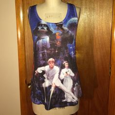 """NWOT Star Wars Soft Tank Sz M NWOT Star Wars super soft print tank size medium. In new condition. Measurements: chest: 20"""", waist: 19"""", total length: 27.5"""". Her Universe Tops Tank Tops"""