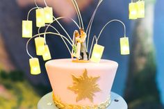 Tangled themed wedding cake with Flynn and Rapunzel cake topper