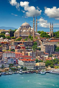 The Suleymaniye Mosque (Süleymaniye Camii, 1550-1558) on the Third Hill with a ferries on the banks of the Golden Horn in the foreground, Istanbul Turkey.   Photos Gallery