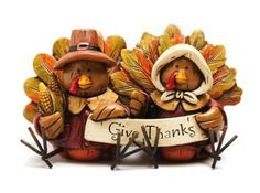 "Give Thanks Turkeys Sit-about by Peachy Kitchen. $12.99. ""Give Thanks"". Multi-colored. Painted resin. 4.25"" L x 2.5"" W x 2.5"" H. A fun seasonal accent piece. A sweet celebration of the season, this decorative sculpture is at once whimsical and thoughtful. The two turkeys are dressed up as pilgrims, and with ears of corn under one wing, they hold up a banner declaring, ""Give Thanks."" They are sure to catch the eye and bring a smile to the face of every guest who stops by, makin..."