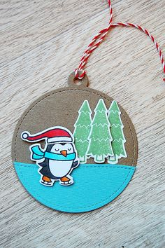 A tag for 12 Tags of Christmas with a Feminine Twist at Ellen Hutson, inspired by Sandy's tag on Day 1 (colors, circle tag die and red twine from Lawn Fawn). Also with Winter Penguin and Toboggan Together by Lawn Fawn. :)