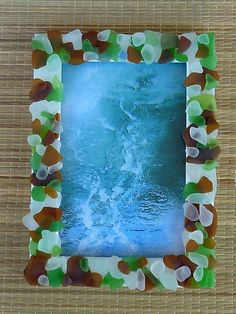 Layered onto this standing picture frame, the sea-glass glows and shines and reflects the light.