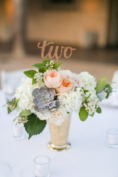 succulents floral arrangement centerpiece with table number - photo by Anna Marks Photography