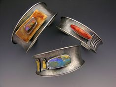 Bracelets | Elaine Rader. Sterling silver, gold and stones.