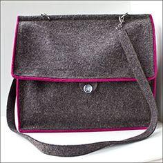 Reuse an old wool felt coat to make a Coach inspired messenger bag.