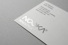 Nooka silver foiled business card