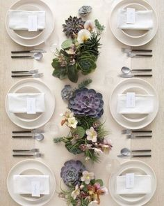 Clean and simple table  not succulents but flowers and lots of greens LOVE the neat and tidy tablescape