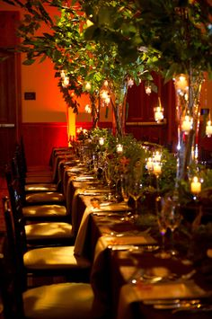 Love the table setting with lots of candles and high center pieces