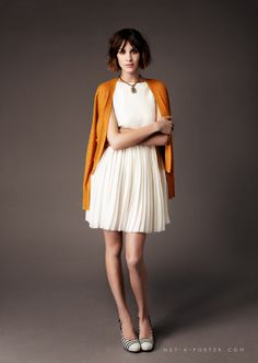 Net-A-Porter put together a cute outfit: mustard cardigan, white top over pleated white skirt (as worn by Alexa Chung).