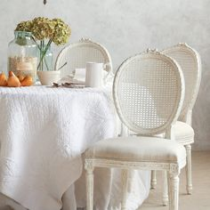 A lovely French-inspired shabby chic dining space with a King Louis style Antique White Cane Dining Chair Cane Back Chairs, Table And Chairs, Dining Chairs, Dinning Table, Vintage Bedroom Furniture, Home Furniture, Furniture Design, Romantic Kitchen, Adirondack Chair Plans Free