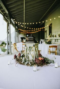 This lantern surrounded by a flower wreath makes a great table centerpiece. Photo: Streetlight Republic