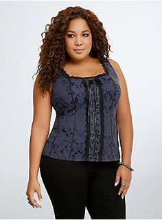 Old-school corsets are making a new-school comeback. While the Victorian-inspired navy blue floral print is totally throwing it back, the sexy-lace up front and black stretch panel on the back is all about the now and the comfortable.