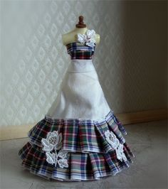 Tartan rose. SORRY I AM NOW SOLD Lovely scottish themed ballgown in white with tartan hand pleated ribbon to skirt and bodice. Embroidered white roses adorn the gown with genuine ab swarovski crystal cluster centres. Lovingly handmade on a 5 inch top quality mannequin
