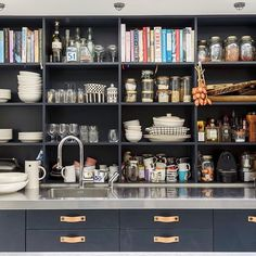 Open shelving at madabouthehouse.com painted in Farrow & Ball Railings with leather handles from superfront.com